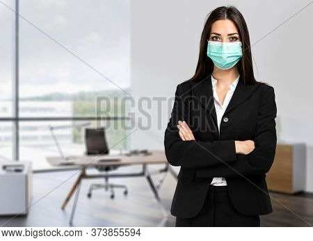 Smiling businesswoman wearing a mask, coronavirus concept