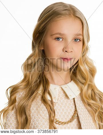 Photo Beautiful Blonde Girl With Long Hair In Curls. Stylish Fashionable Classic Clothes. Look At Ca