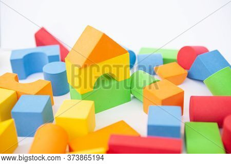 Bright Multi-colored Details Of The Designer. Children's Toy On A White Background. Background Of Co