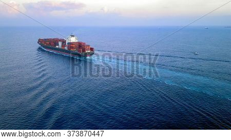 Large Container Ship At Sea, Loaded With Various Container Brands. Ulcv Container Ship Sails On Open