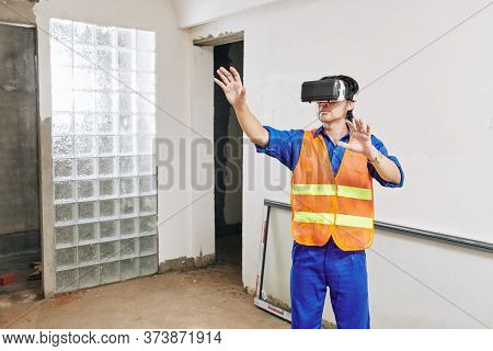 Contractor Using Virtual Reality Glasses To Visualize Project Of Apartment He Is Working On