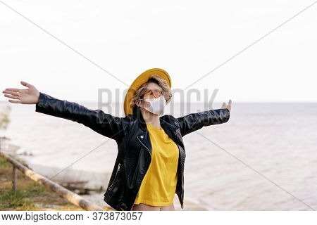 Young Woman Wearing Surgical Face Mask By River. Self Isolation In Nature. Corona Virus Pandemic. Ho