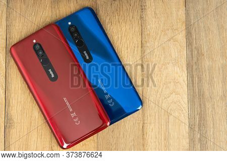 Varna, Nulgaria - May 16 , 2020: The Back Of Redmi 8 Android Smartphones In Ruby Red And Sapphire Bl