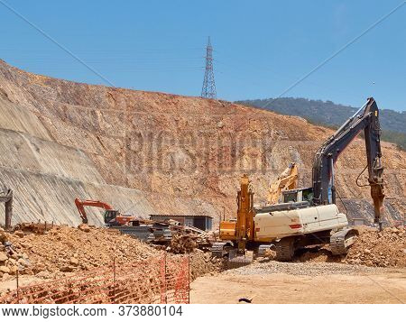 Excavator And Hydrohammer During Quarrying On The Rocky Soils. Heavy Machinery At Earthmoving, Diggi
