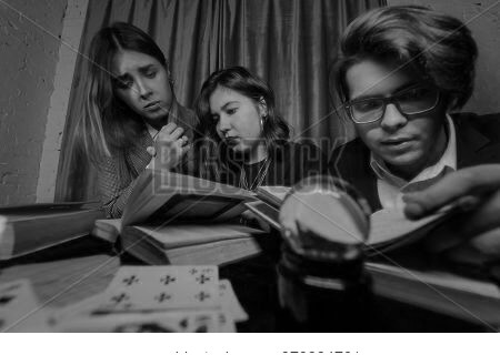 Two Women And A Guy Are Reading A Mysterious Books, Close View