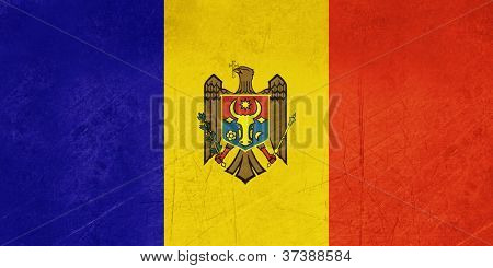 Grunge sovereign state flag of country of Moldova in official colors.