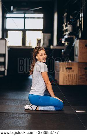 Young Yoga Woman Kneeling On The Floor.