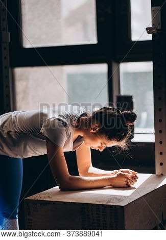 Beautiful Woman Leaned Over The Table Against Window