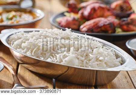 indian basmati rice in metal bowl with roasted cumin seeds