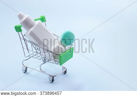 Contact Lenses In The Grocery Cart On A Blue Background. Contact Lens Shopping Concept.