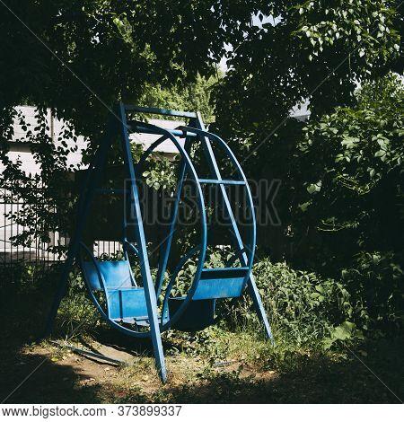 Blue Metal Swing. Empty Swing. Children's Swing.