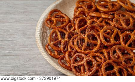 Pretzels On A Plate On The Kitchen Table. Snack On Beer. Salty Snack. Crispy Pretzels.