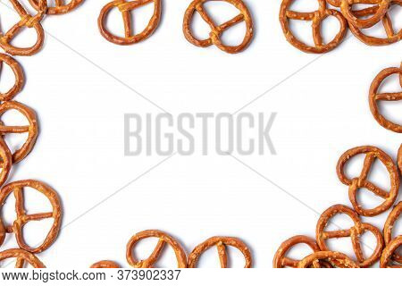 Crispy Pretzels Isolated On A White Background With Place For Text. Snack On Beer. Salty Snack. Cris