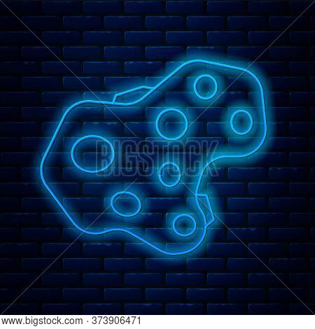 Glowing Neon Line Asteroid Icon Isolated On Brick Wall Background. Vector Illustration