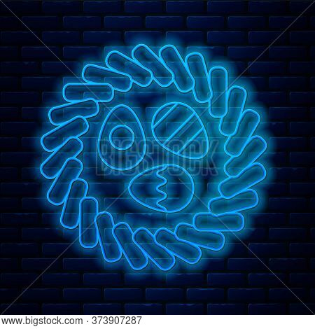 Glowing Neon Line Easter Egg In A Wicker Nest Icon Isolated On Brick Wall Background. Happy Easter.