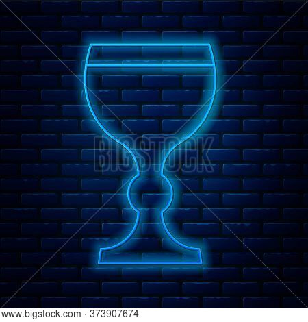 Glowing Neon Line Wine Glass Icon Isolated On Brick Wall Background. Wineglass Icon. Goblet Symbol.