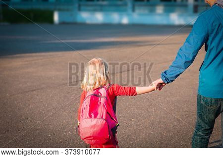 Father And Little Daughter Going To Shool