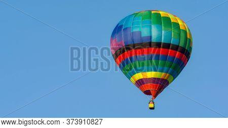 Balloon Flying High In The Sky. Balloon Basket With People. Aeronautic Sport. Burning Gas. Bright Mu