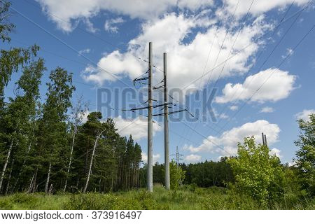 High Voltage Poles For High Voltage Transmission. High Voltage Poles Are Standing On The Edge Of The