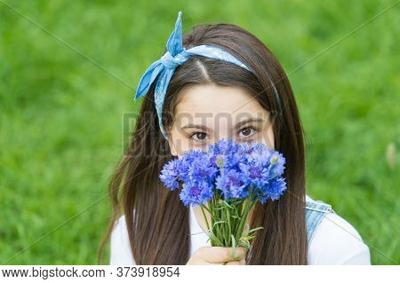 Spring Flowers Bring New Life. Little Child Hold Flowers Outdoors. Beauty Look Of Small Child. Flowe