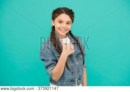 The Best You Can Be. Happy Girl Give Thumbs Up Blue Background. Little Child Smile Gesturing Thumbs