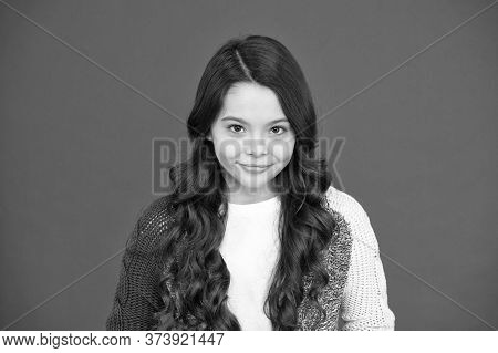 Gorgeous And Beauty Which You Deserve. Little Beauty Red Background. Small Girl With Long Brunette H