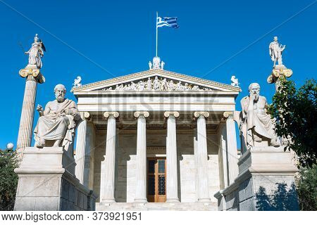 Athens, Greece - March 16, 2018: The Main Entrance Of The Academy Of Athens With Statues Of Greek Ph