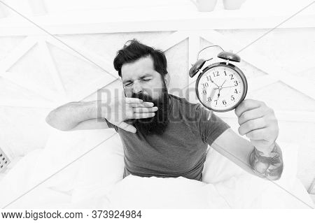 Need To Sleep Longer. Man Hipster Want To Sleep. Male On Bed Yawning. Mute The Alarm Clock. The Morn