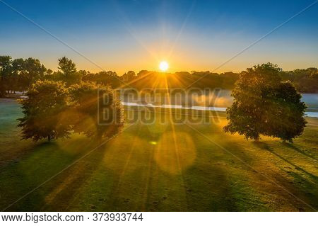 Sunny Morning In The Park, Aerial Footage In The Englischer Garten Of Munich, Sunbeams Are Shining T