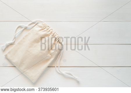 Canvas Bag With Drawstring, Mockup Of Small Eco Sack Made From Natural Cotton Fabric Cloth Flat Lay