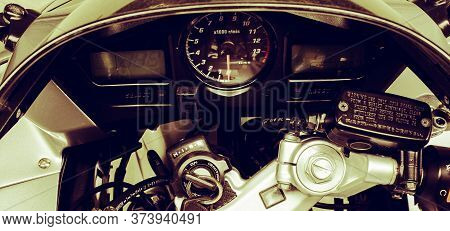Dashboard With Motorcycle Speedometer And Tachometer Close Up. Sports Bike Steering Wheel With Elect