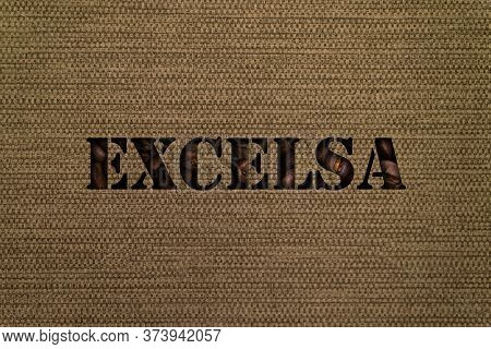 Excelsa Text Made Up Of Coffee Beans On A Canvas Background From A Bag