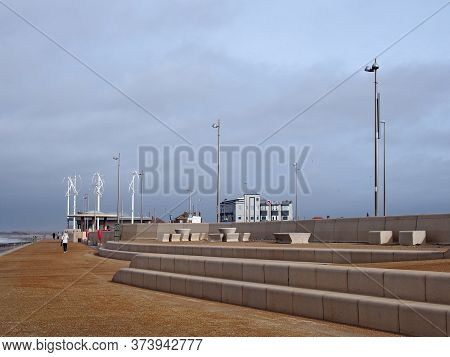 Blackpool, Lancashire, United Kingdom - 6 March 2020: People On The Promenade Along The Seafront At