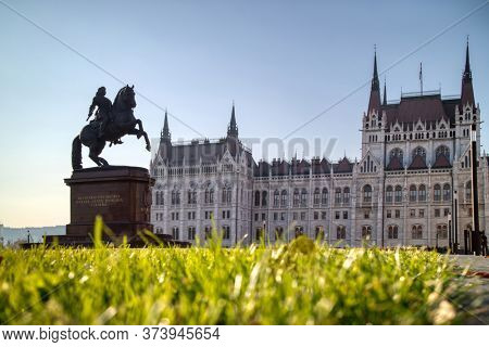 Wonderful monument Rakoczi Ferenc equestrian statue before Hungarian paliament building with green grass forefront in Budapest, Hungary.