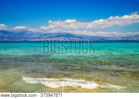 Crete Island Seascape Background. Greece Travel Background with Turquoise Sea and Blue Sky.
