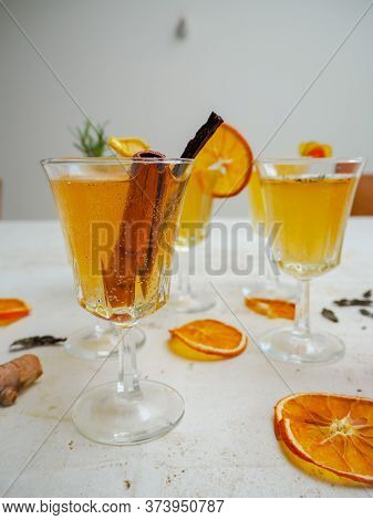 Multiple Glasses With A Variety Of Flavored Kombucha Tea Such As Cinnamon, Turmeric And Citrus On A