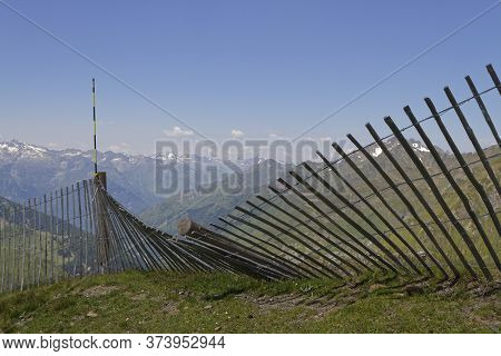 Fence In Mountain Landscape. Col Du Tourmalet Is The Highest Paved Mountain Pass In The French Pyren