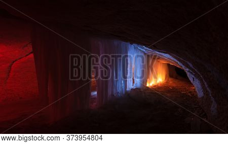 Underground Icicles And Ice Stalactites In The Cave Near Village Kulogory, Arkhangelsk Region, Russi