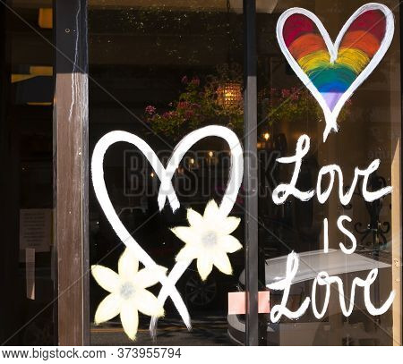 Babylon, New York, Usa - 28 June 2020: A Stores Window Is Decorated With Hearts And Text Saying Love