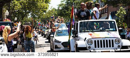 Babylon, New York, Usa - 28 June 2020: Decorated In Rainbow Colors Cars Driving Up Deer Park Ave Wit