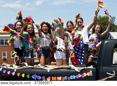Babylon, New York, Usa - 28 June 2020: Back Of A Truck Has Young Girls With Rainbow Flags Participat