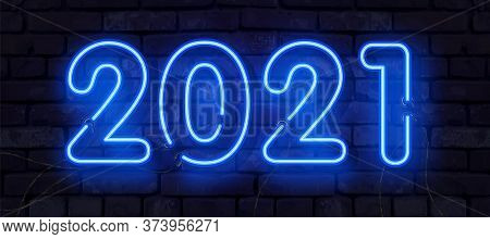 Blue Realistic Neon 2021 Happy New Year Neon Banner. Realistic Bright Neon Billboard On Brick Wall.