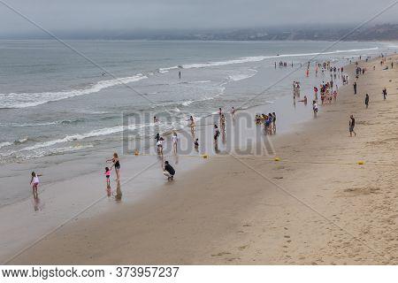 Santa Monica, California, Usa- 11 June 2015: People On The Wide Santa Monica Beach. Pacific Ocean.