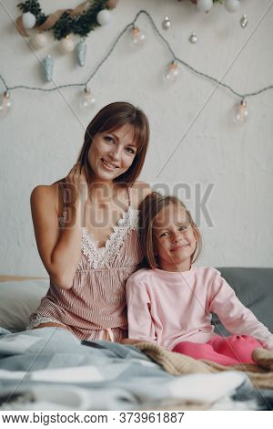 Mother And Little Daughter Child Girl At Home.