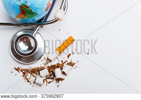 31 May Of World No Tobacco Day, No Smoking, Close Up Of Broken Pile Cigarette Or Tobacco And Doctor