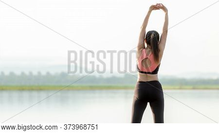 Lifestyle Woman Yoga Exercise And Worm Up Raise Arm Before Pose For Healthy Life. Young Girl Or Peo