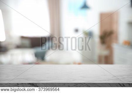 Empty White Marble Table In Modern Kitchen Interior