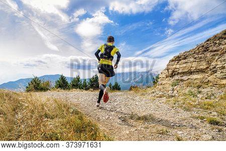 Athlete Runner Run Mountain Trail Marathon In Background Blue Sky