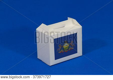 Pennsylvania Flag On White Box And Barcode On Blue Background. The Concept Of Export Trading From Pe
