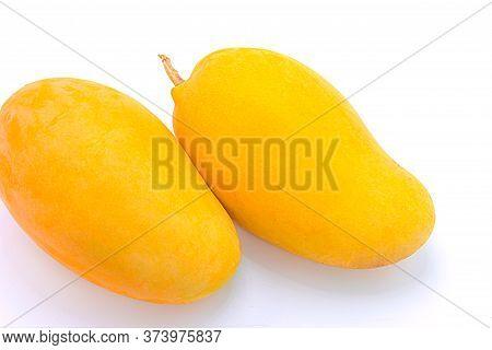 Close Up Ripe Mango Isolated On White Background.